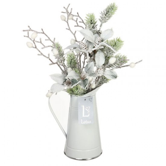 Christmas Flower Arrangements Snow Covered Greenery In White Jug